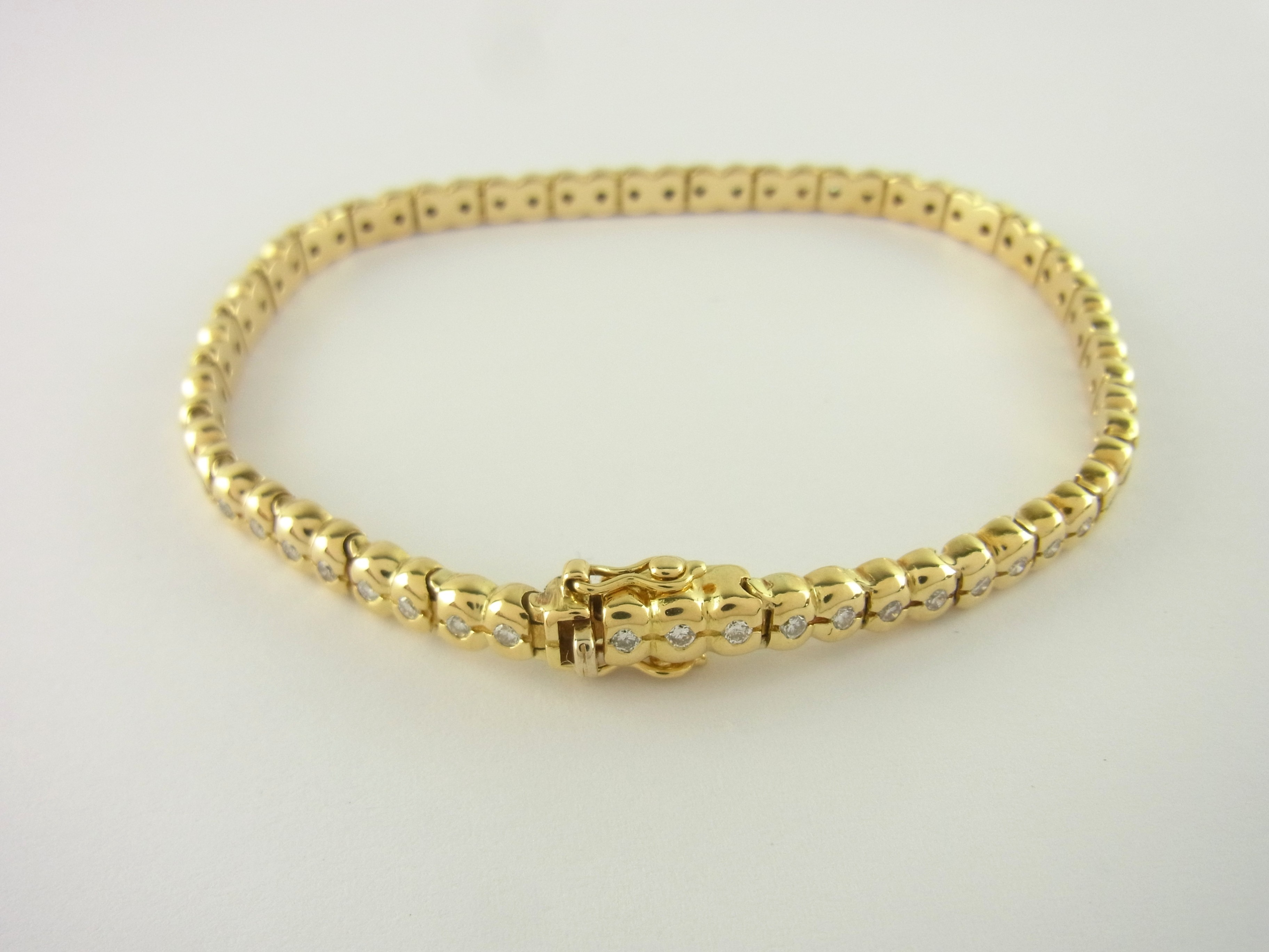 tennis armband wempe 18 kt gelbgold mit diamanten. Black Bedroom Furniture Sets. Home Design Ideas